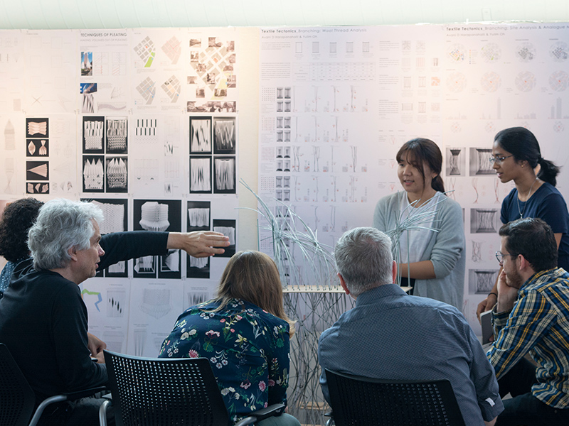 Bachelor of Science Students present their studio project in front of jurors in the Architecture West atrium.