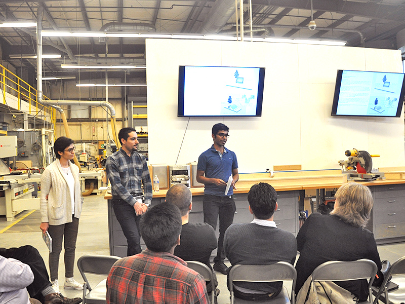 Students present research on the reuse of wind turbines for industry professionals in the Digital Fabrication Lab