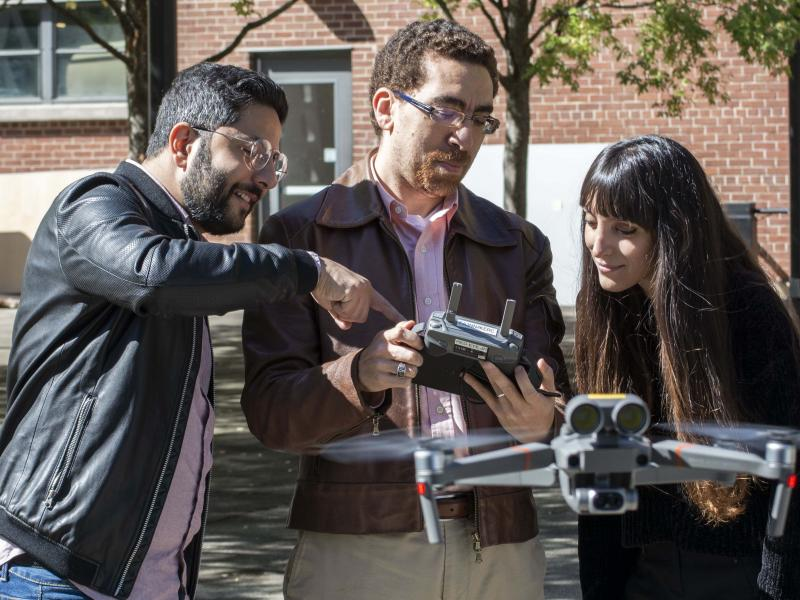 High Performance Building Lab director, Tarek Rakha, and students with a drone in the Hinman Courtyard.