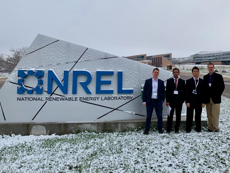 Student team from Georgia Tech standing in front of the NREL sign after the Department of Energy's Solar Decathalon in Colorado.