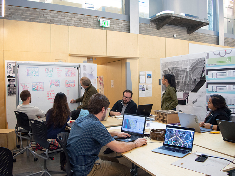 Associate professor, Michael Gamble, works with students during his Fall 2018 studio in the Hinman Research Building.