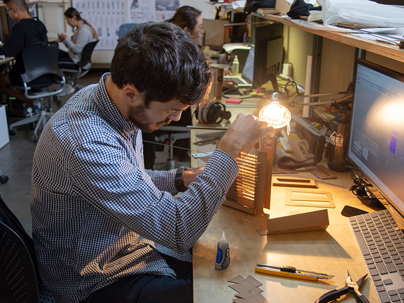 M.Arch Student, Alex Knight, observes how light passes through his model for Keith Kaseman's Fall 2018 studio.
