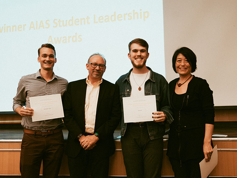 Students Chris Tromp and Colt Brock accepting their American Institute of Architecture Students Leadership Award at the 2019 Awards Day program in the Reinsch-Pierce Family Auditorium.