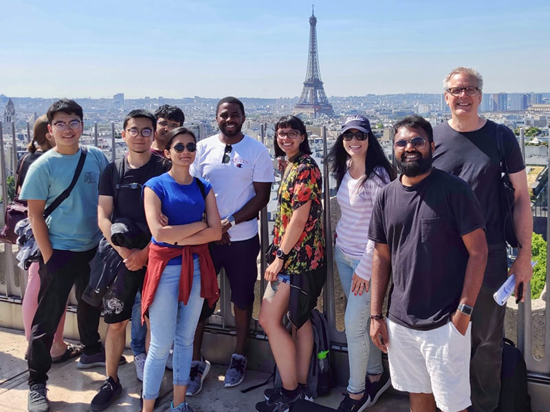 Students and associate professor, W. Jude LeBlanc, in Paris, France viewing the Eiffel Tower from a distance.