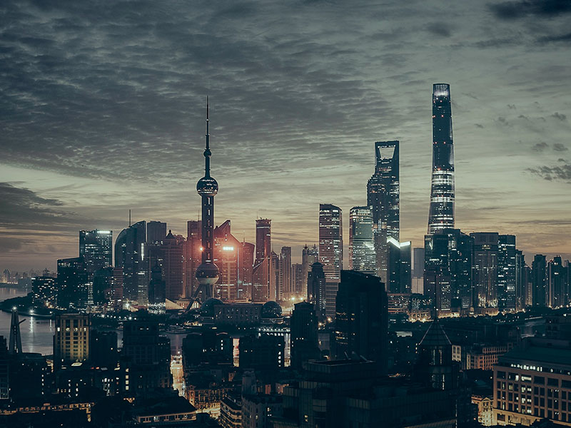 Shanghai Skyline in the evening, photo by Adi Constantin on Unsplash.