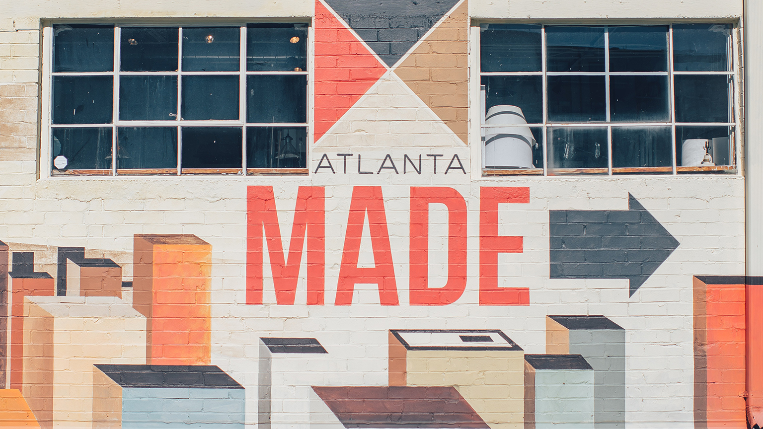 Building mural with a cityscape and the text Atlanta Made. Photo by Ian Schneider on Unsplash.