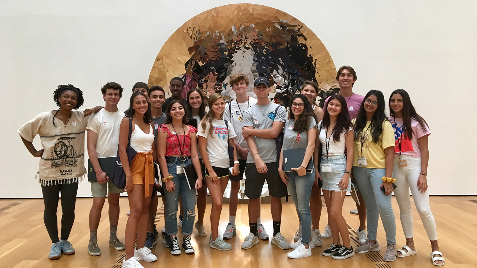 Students from the Summer 2019 Pre-College Camp stand in front of the sculpture at the High Museum of Art.