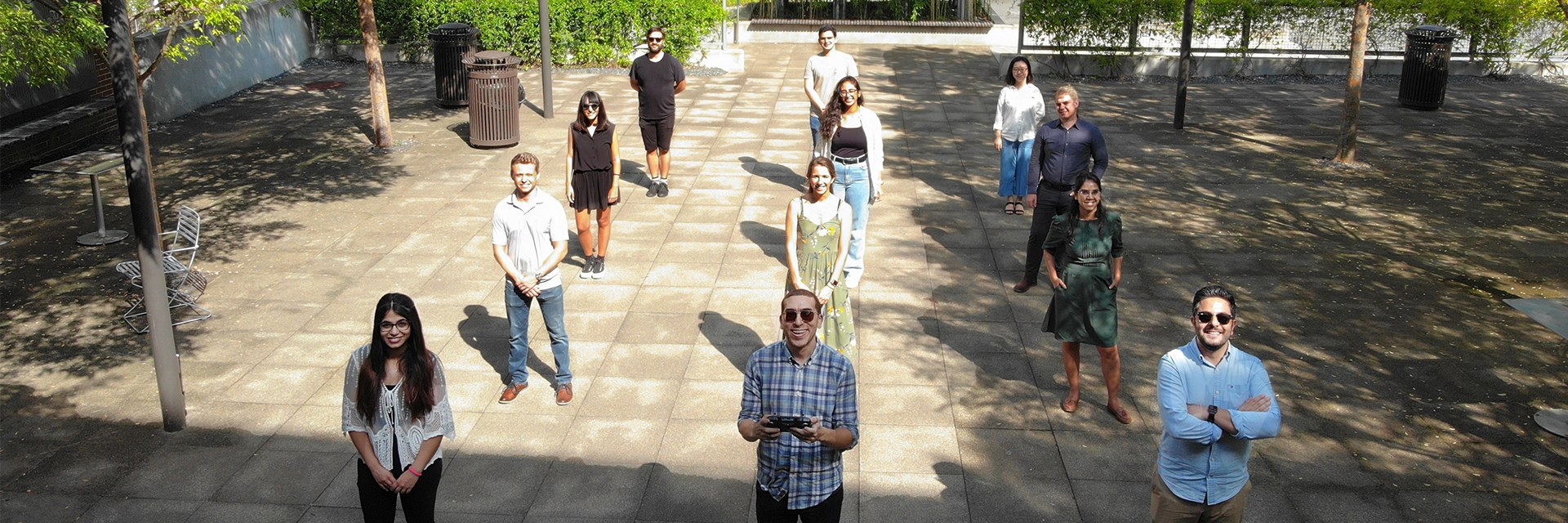 Group photo captured by a drone of students and faculty in the High Performance Building Lab, all standing 6-feet apart in the Hinman Courtyard.
