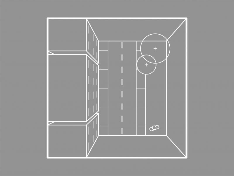 Greyscale icon of a street block showing a building and a road.