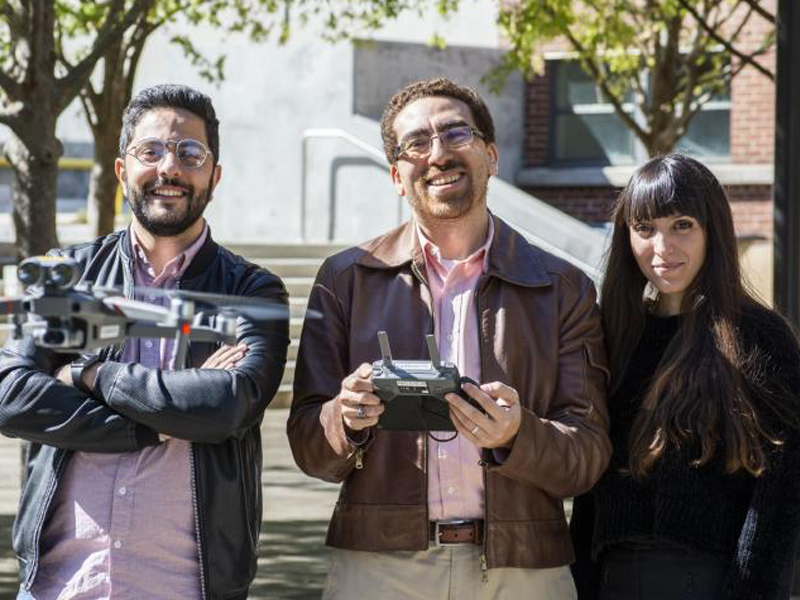 Yasser El Masri, Tarek Rakha, and Eleanna Panagoulia fly a drone in the Hinman Courtyard.